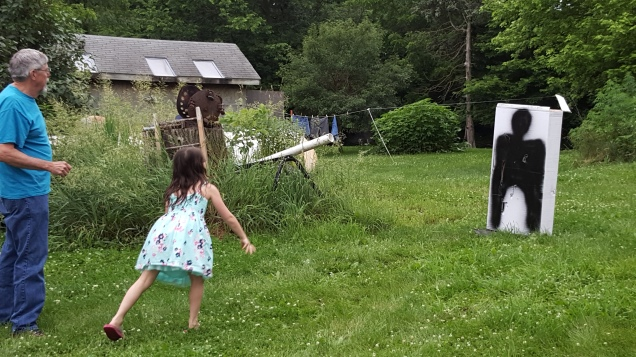 My sweet baby cousin (also my mini-me) showin g us all how it is done with one throw.  I want her on my apocalypse team....